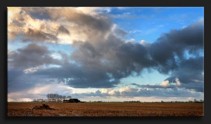 Oostmahorn Friesland - Stormy Sky Oostmahorn Netherlands with a farm